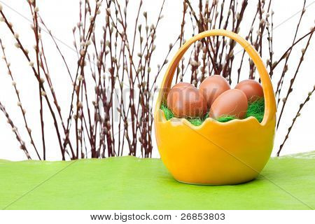 Basket full of Easter eggs and willow twig