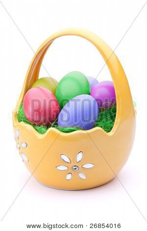 Basket full of Easter eggs isolated on white