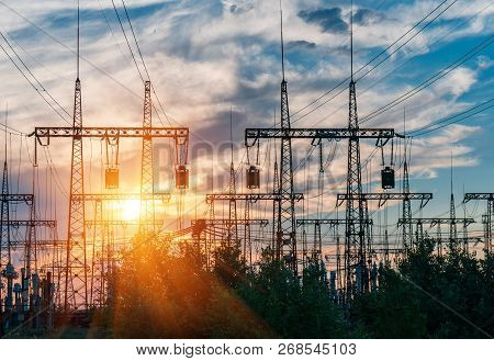 High-voltage  Power Lines. Electricity Distribution Station. High Voltage Electric Transmission Towe