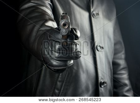 Bandit Directs Gun On Black Background Closeup