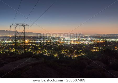 Los Angeles California predawn mountain view of power lines entering the San Fernando Valley.  The San Gabriel Mountains are in background.