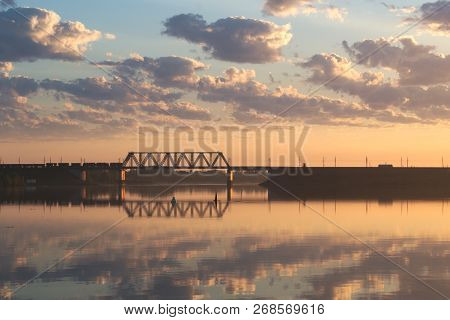 Railway Bridge Over The River. The Train Just Passed Over The Bridge. The Light Of The Rising Sun Il