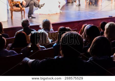 Spectators At A Theater Performance, In A Cinema Or At A Concert. Shooting From Behind. The Audience