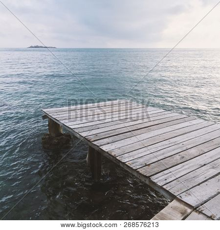 The Old Wooden Pier With Panoramic Deep Blue Sea View In Tranquility Moment Before Sunset. Holiday C