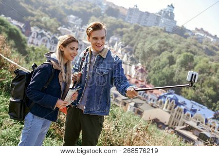 Happy Young Couple Of Tourists Takes Selfie Portrait On European Country