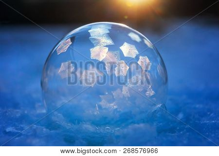 First image in a science experiment series of frozen bubble with ice crystals,  ice crystals just starting to form