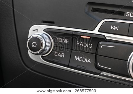 Media And Navigation Control Buttons Of A Modern Car. Car Interior Details. Black Leather Interior O