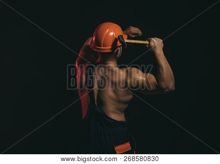 Area Is Currently Under Construction. Muscular Man Builder At Work Under Construction. Hard Worker U