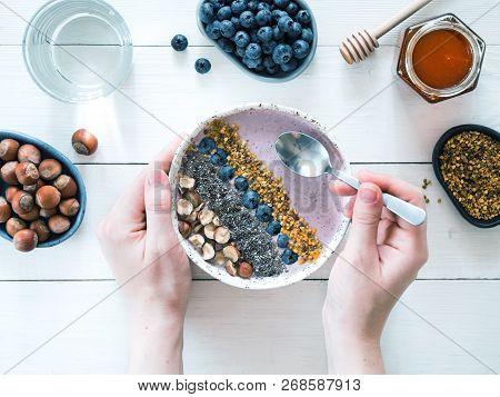 Eating Healthy Breakfast Bowl. Buckwheat Smoothie Porrige, Fresh Berries, Seeds And Nuts, Bee Pollen