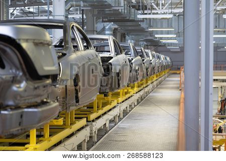 Body Of Car On Conveyor Modern Assembly Of Cars At Plant. Automated Build Process Of Car Body