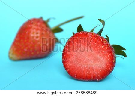Strawberry Fruit, Fragaria Sp., On Blue Background