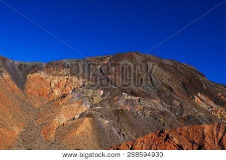 Moon Over Zabriskie Point Mudstones Form Badlands Death Valley National Park California.