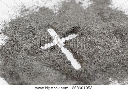 Christian Cross Or Crucifix Drawing In Ash, Dust Or Sand As Symbol Of Religion, Sacrifice, Redemtion