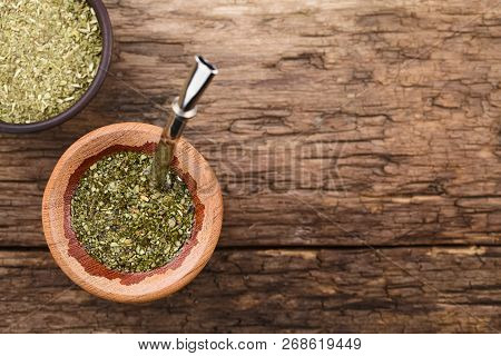 Traditional South American Yerba Mate Tea In Wooden Mate Cup With Bombilla Metal Straw Serving As A