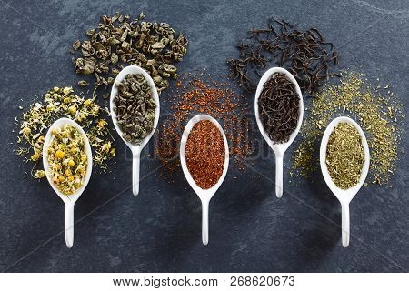 A Variety Of Loose Dried Tea Leaves On Spoons (chamomile, Green, Rooibos, Black And Mate Tea), Photo