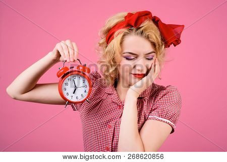 Sleepy Girl With Vintage Clock. Pin-up Housewife With Alarm-clock. Sexy Girl In Red Dress Holds Alar