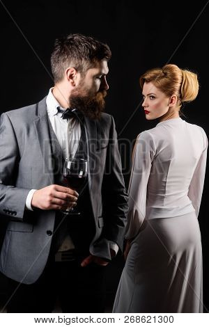 Elegant Couple With Red Wine. Romantic Couple Spending Time Together. Handsome Man With Glass Wine.