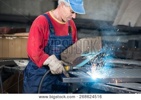 Black smith welding pieces of metal together
