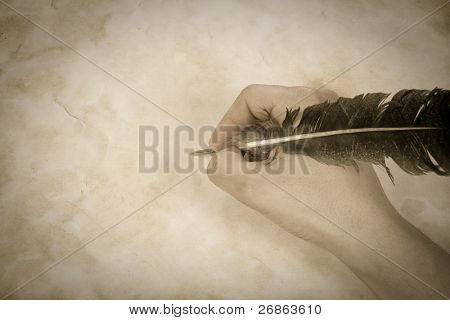vintage image writing hand with feather