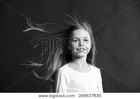 Natural Beauty. Girl Kid Long Hair Flying In Air, Black Background. Child With Natural Beautiful Hea