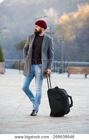 Ready To Travel. Carry Travel Bag. Business Trip. Man Bearded Hipster Travel With Big Luggage Bag On