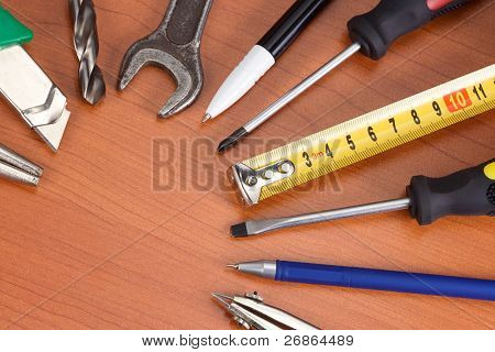 tools, pencil and pens at table