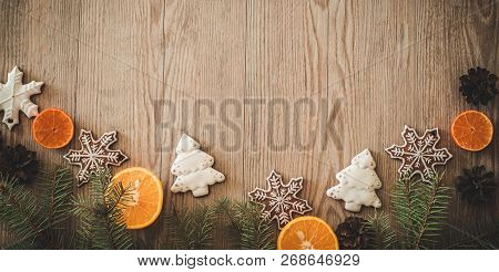 Christmas Holidays Composition On Wooden Background With Copy Space. A Branch Of A Christmas Tree, C