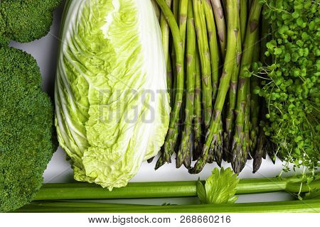 Background Of A Lot Of Fresh Green Different Vegetables And Herbs, Top View, Close-up. The Concept O