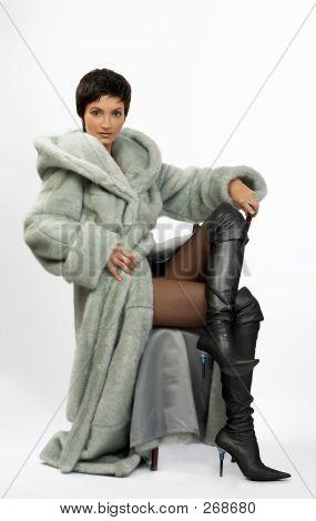 Beautiful Young Woman In A Fur Coat