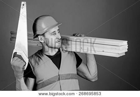 Woodcraft Concept. Carpenter, Woodworker, Labourer, Builder On Thoughtful Face Carries Wooden Beams