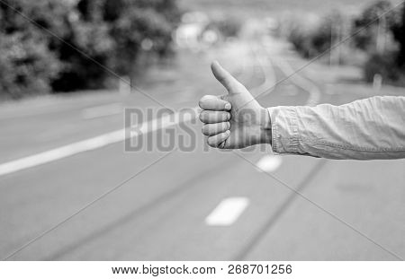 Hand Thumb Up Gesture Try Stop Car Road Background. Thumb Or Hand Gesture Hitchhiking. Make Sure You