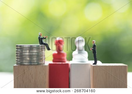 Miniature Businessman Face To Face For Negotiating In Business. Strategy Concept And Business Compet