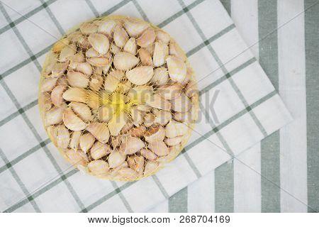 Close Up Of Garlic In Yellow Net. Thai Seasoning And Herb