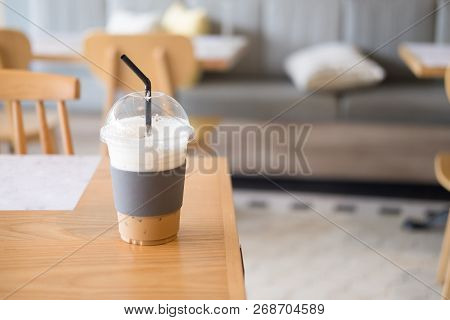 Ice Coffee Plastic Glass  In Coffee Shop