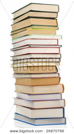 pile of new and old books isolated on white background