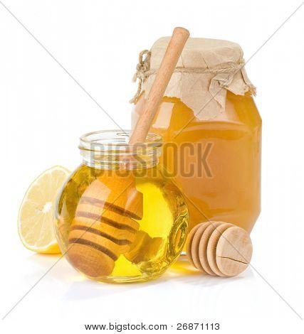 glass jar full of honey and lemon isolated on white background