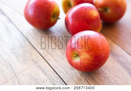 Closeup Fresh Red Apples Fruit On Wood Table Background With Light From Out Door, Food Healthy Diet
