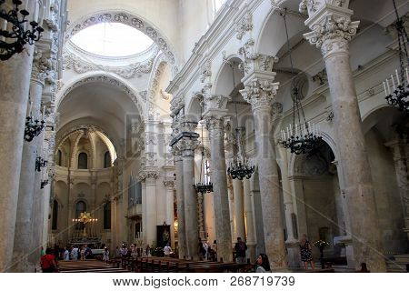 Lecce, Italy -august 28, 2018: People Visit Basilica Di Santa Croce In Lecce, Italy. The Baroque Lan