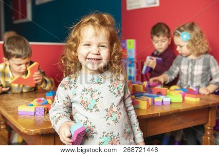 The Preschoolers Group In Kindergarten Together, Nursery Group Play With Block ,