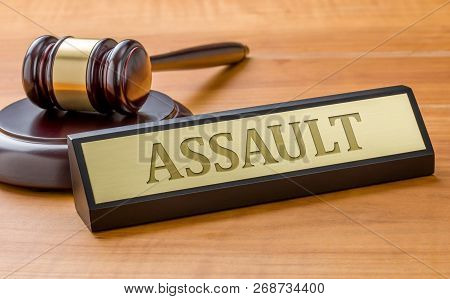 A Gavel And A Name Plate With The Engraving Assault