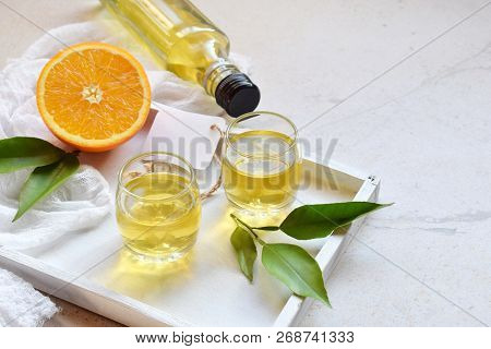 Orange Liqueur In Glass. Delicious Yellow Alcohol Drink. Citrus Liquor. Glass Bottle, Shot. Copy Spa
