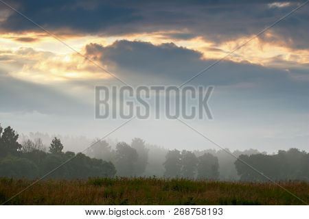 Beautiful Landscape With Mist. Summer Beautiful Idyllic Landscape In Latvia. Meadow, Wood And Sky Wi