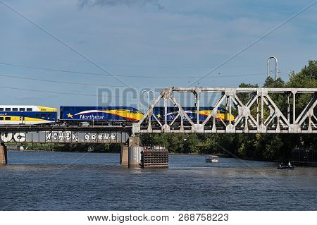 Minneapolis, Mn - September 9, 2018: Northstar Commuter Train Moves East Across Bridge Over Mississi