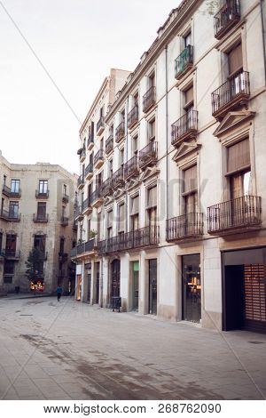 Old Buildings on Cucurulla Street in Barcelona, Spain. Empty Barcelona Street. City Lifestyle. Morning.