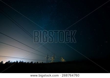 Incredible Night Sky With Stars, Milky Way Passing Over Power Line In Long Exposure Timelapse. Beaut