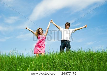 Couple holding hands in a flower field