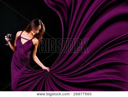 Glamour women with the whine on black background