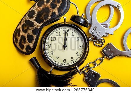 Sex Time Concept. Black Alarm Clock With Sex Toys With Yellow Background.sex Time Concept. Black Ala