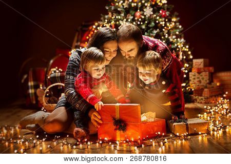 Christmas Family Open Lighting Present Gift Box Under Xmas Tree, Happy Mother Father Children In Mag