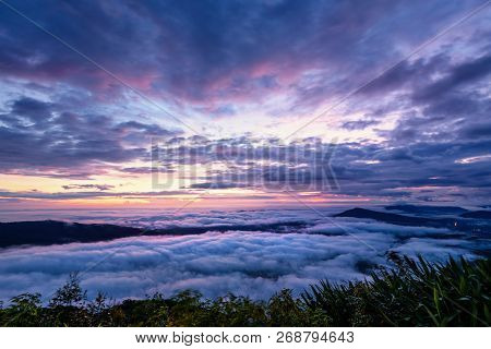 Beautiful Nature Landscape Of The Fog Covers The Summit And The Colorful Sky During Sunrise In The W